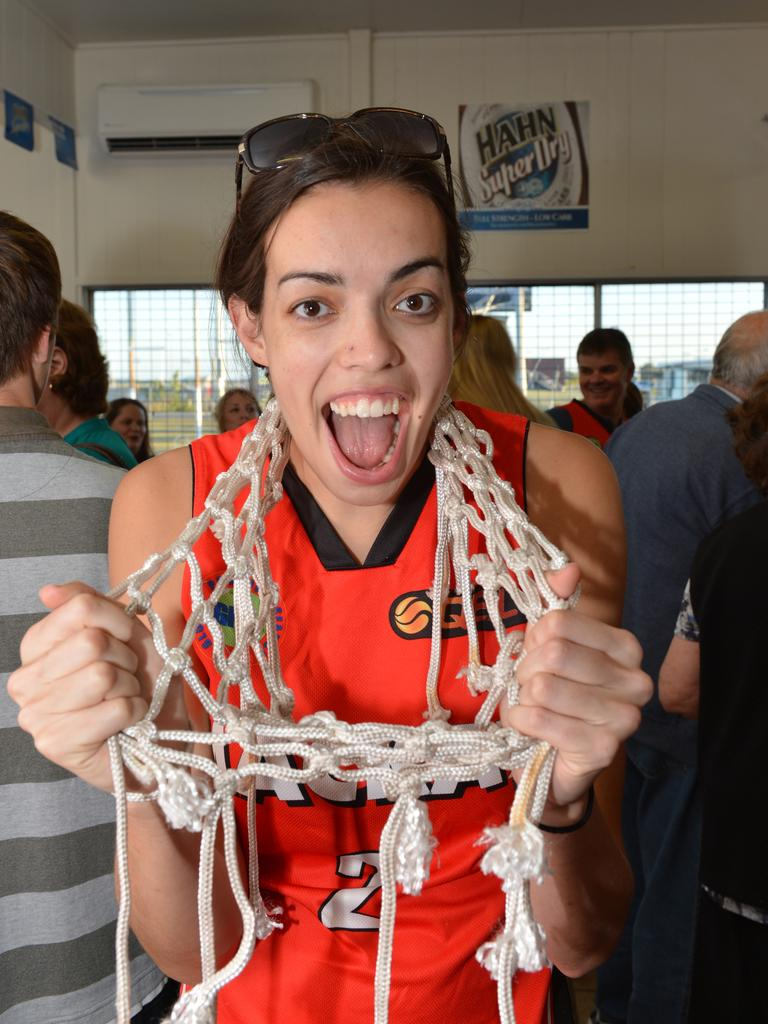 Louella Tomlinson celebrates the Meteorettes' 2012 QBL championship victory. Photo Peter Holt / Daily Mercury