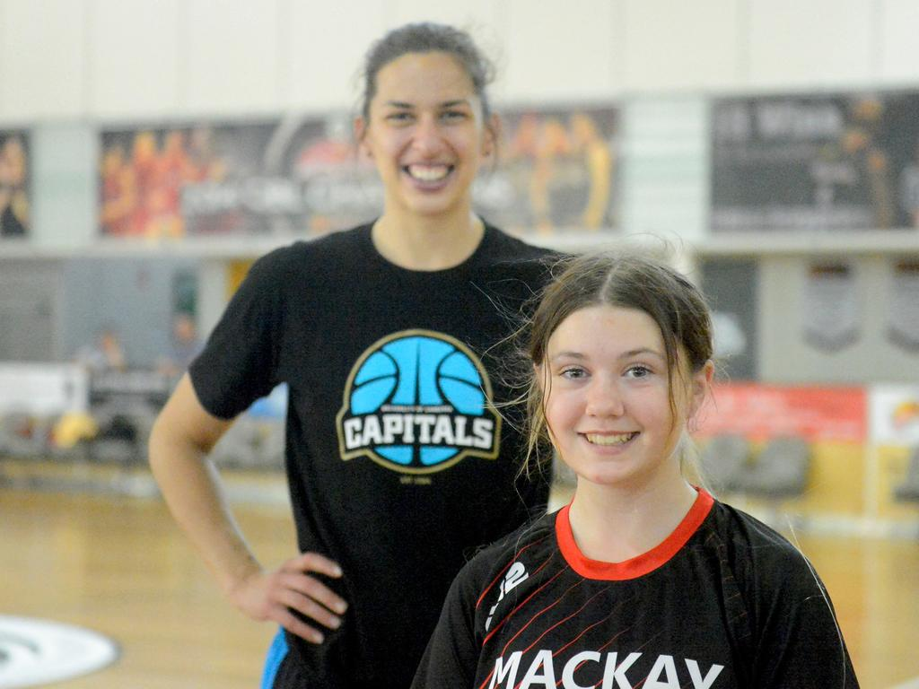 Canberra Capitals star Marianna Tolo with young fan Jaimie McPhee, 12, at the open clinic at Mackay Basketball Stadium on Thursday.