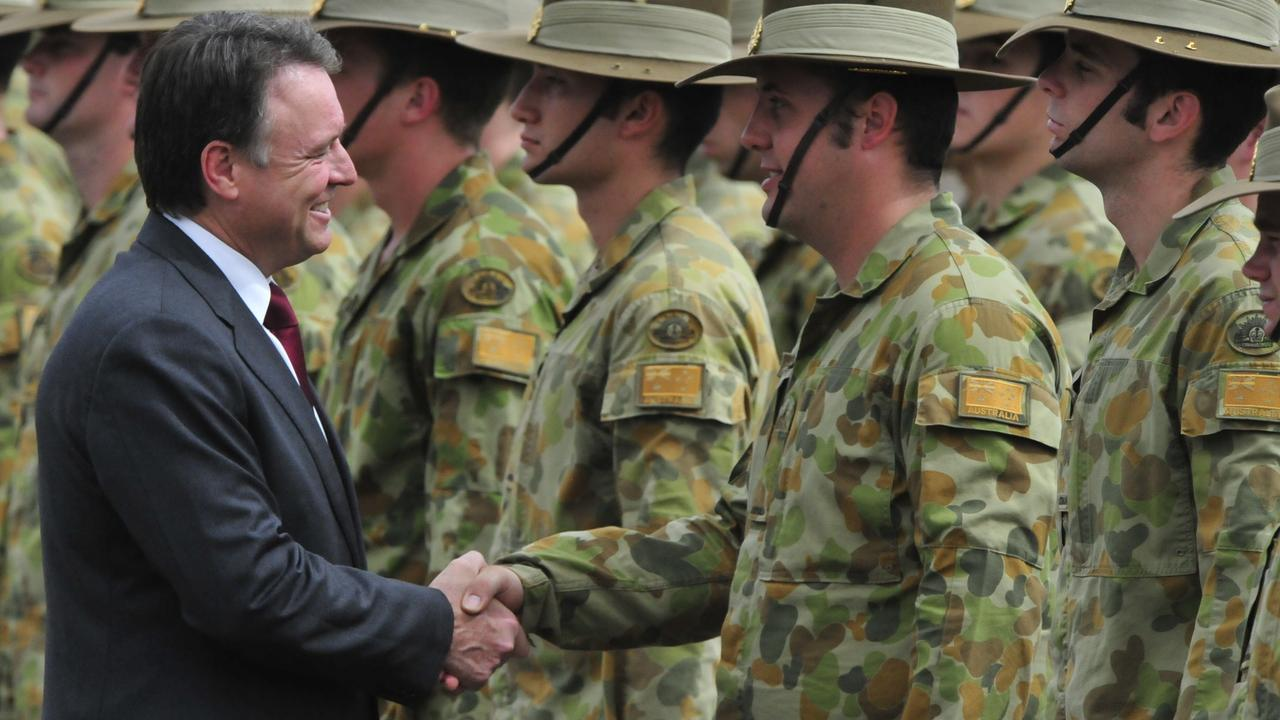 Joel Fitzgibbon as defence Minister in 2009, shaking the hand of a soldier about to be deployed to Uruzgan Province in Afghanistan to mentor the Afghan Army.
