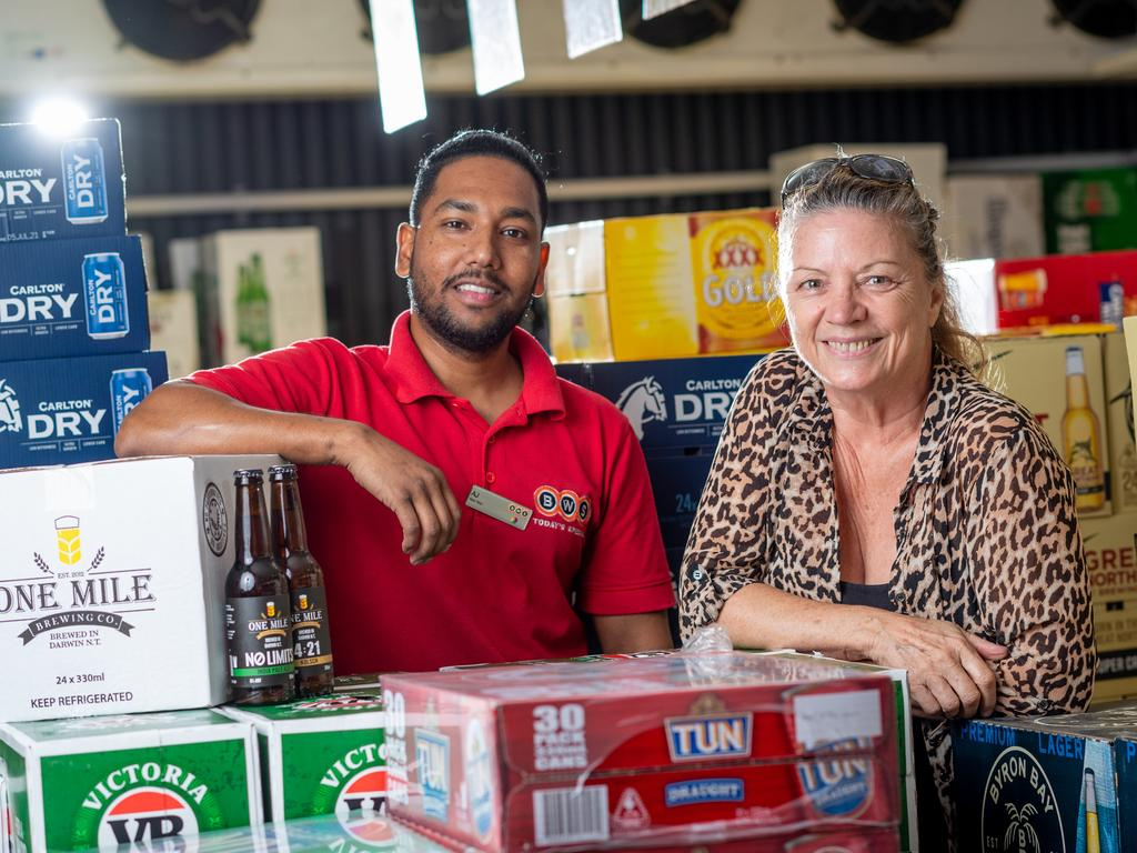 BWS Nightcliff is celebrating a new neighbour as Dan Murphy's takes a step closer to setting up shop in Darwin. Beer Man Anil Sharma and customer Suzie Bee celebrate the news. Picture: Che Chorley
