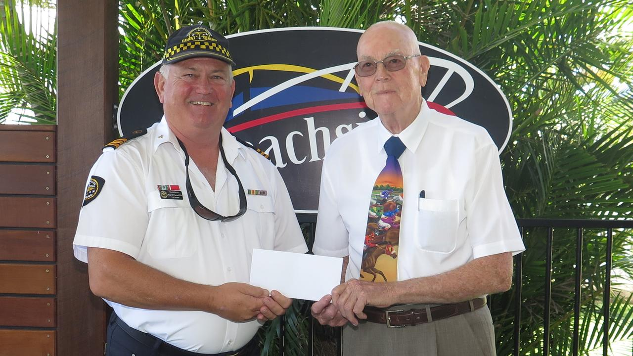 Caloundra Coast Guard Commander, Roger Pearce, receives a cheque for $5000 from CPBC president Joe Keates in the Beachside area of the Caloundra Power Boat Club. Picture: Sally Bick