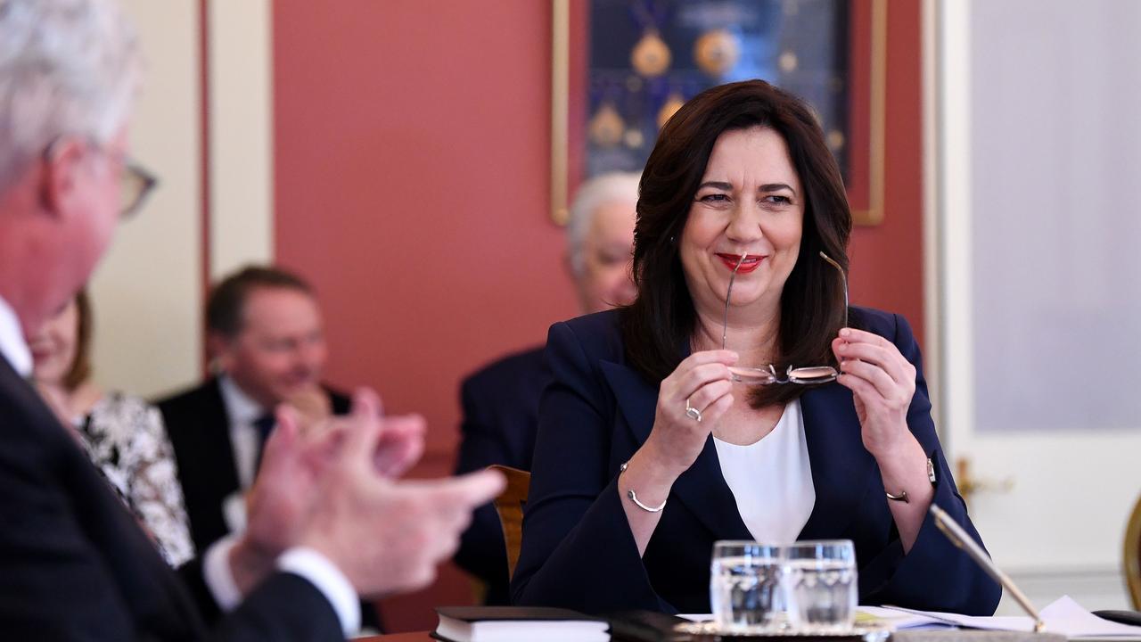 Queensland Premier Annastacia Palaszczuk is seen after she was sworn-in by Queensland Governor Paul de Jersey (left). Picture: NCA NewsWire / Dan Peled