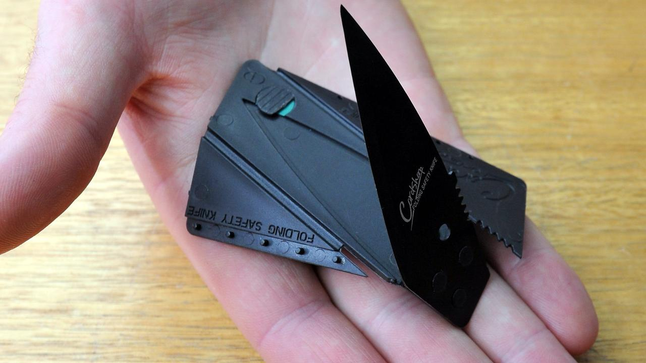 An example of a credit card flick knife. It is the size of a credit card, card is plastic and blade is metal almost like a box cutter knife. The plastic folds around the blade as a makeshift handle.