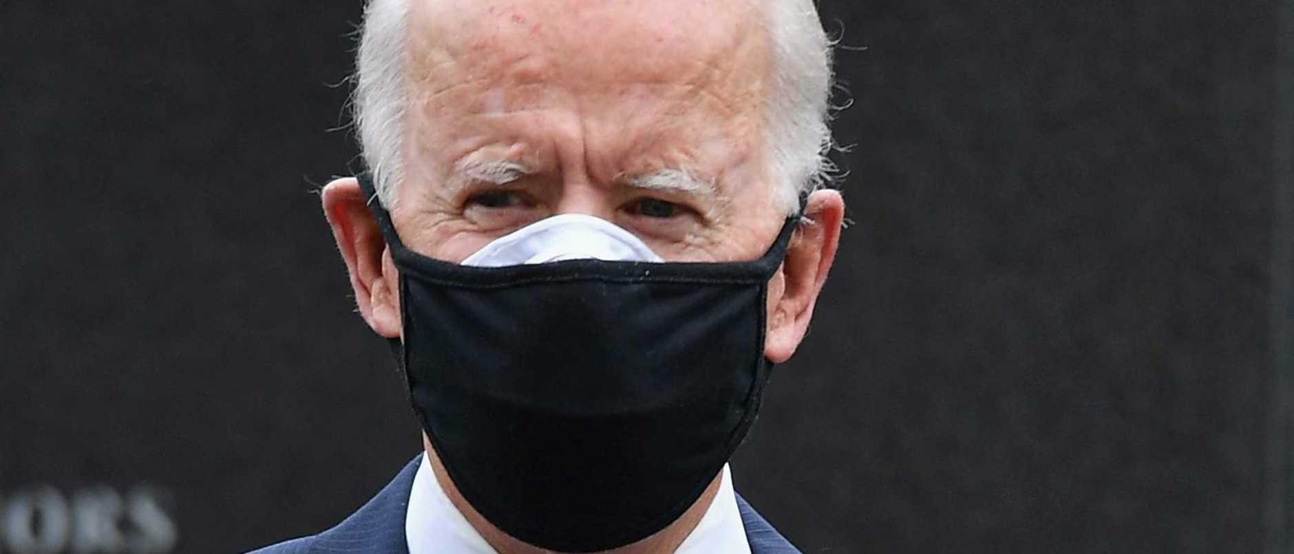 Joe Biden's unusual double mask habit   Queensland Times