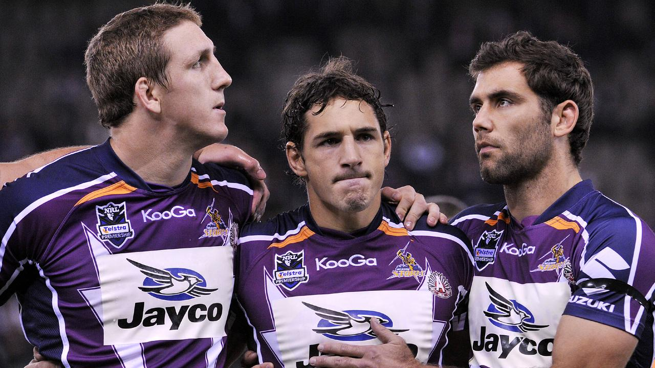 Melbourne Storm captain Cameron Smith playing his first game after the salary cap scandal with Ryan Hoffman and Billy Slater.