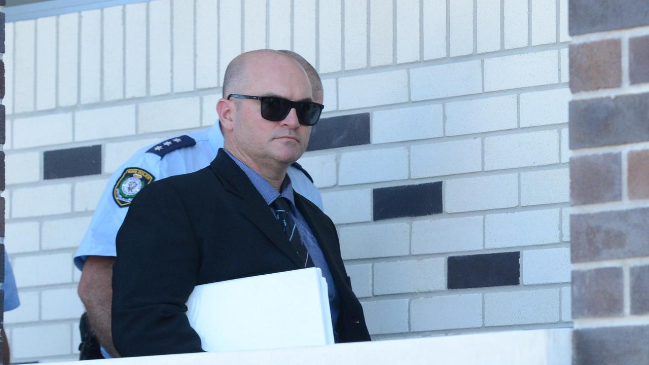 Senior Constable Michial Luke Greenhalgh, 39, leaves Lismore Local Court after the first four days of a hearing during which he has been defending a charge of common assault. The hearing will continue in the new year. Picture: Liana Boss