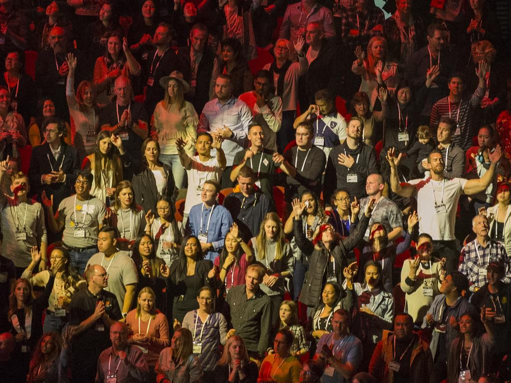 Worshippers inside a Hillsong conference in Sydney. Hillsong attracts young people with its rock-music sermons, and postmodern approach to worship where jeans and T-shirts are Sunday best.