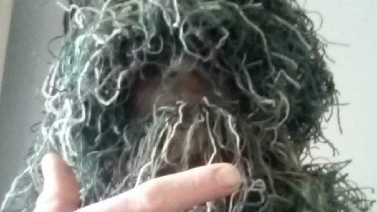 Trevor Clint Gibson hid in a bush at a Gladstone school and called out to children while wearing a Ghillie suit.