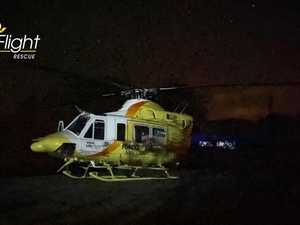 Child flown to hospital after falling in campfire