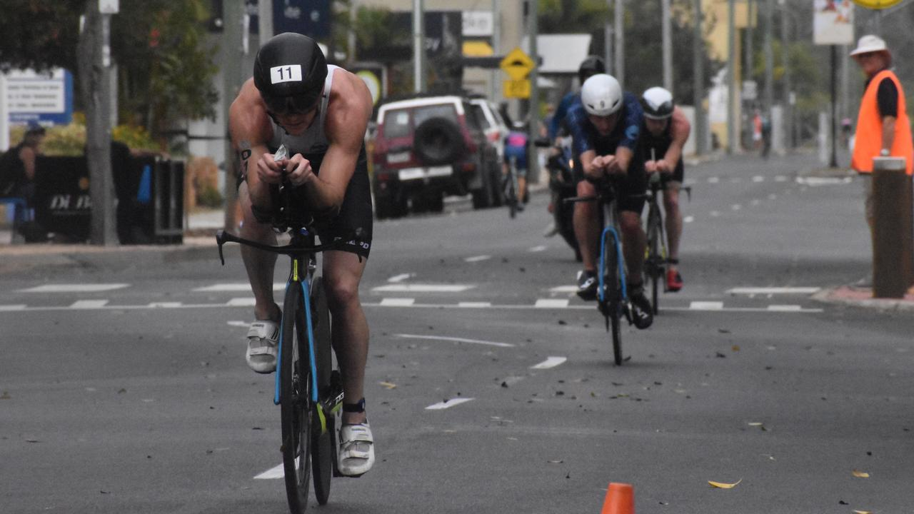 TRIATHLON: Competitor Steven McKenna leads the men's open category during the bike leg of the Hervey Bay 100. Photo: Stuart Fast