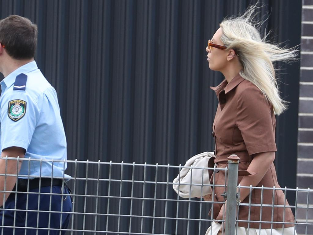 Ex wife Phoebe Burgess arrives at court on the first day of the hearing. Picture: John Grainger