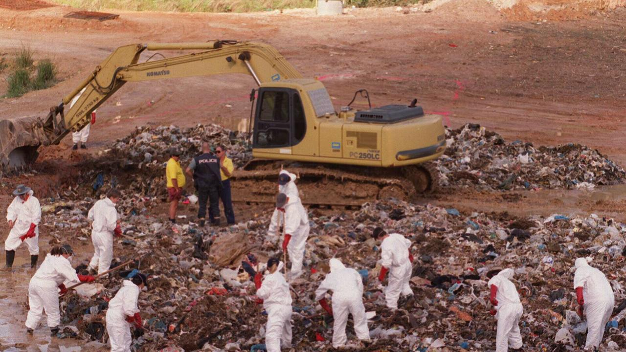 Police search through a rubbish at Labrador tip for the body of Japanese millionaire Hamago Kitayama. Picture: TROY PURDUE