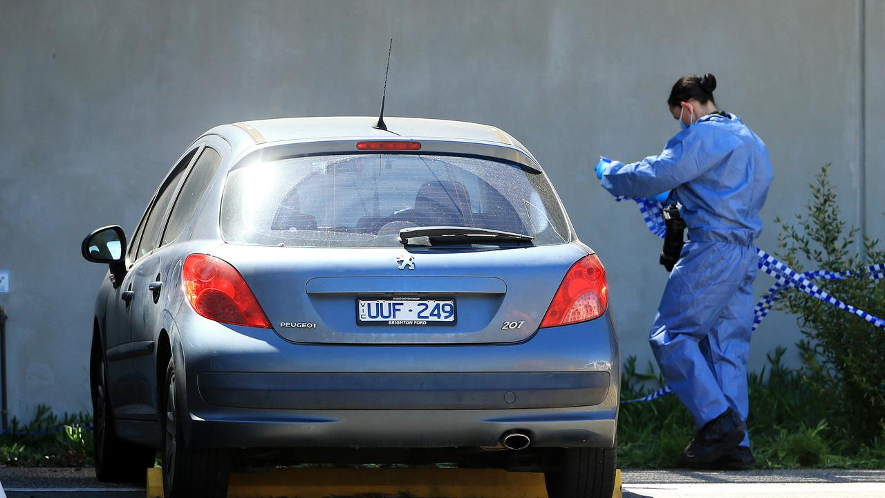 Forensics examine a car outside Mernda police station at a second crime scene after an woman was found dead. Picture: Mark Stewart