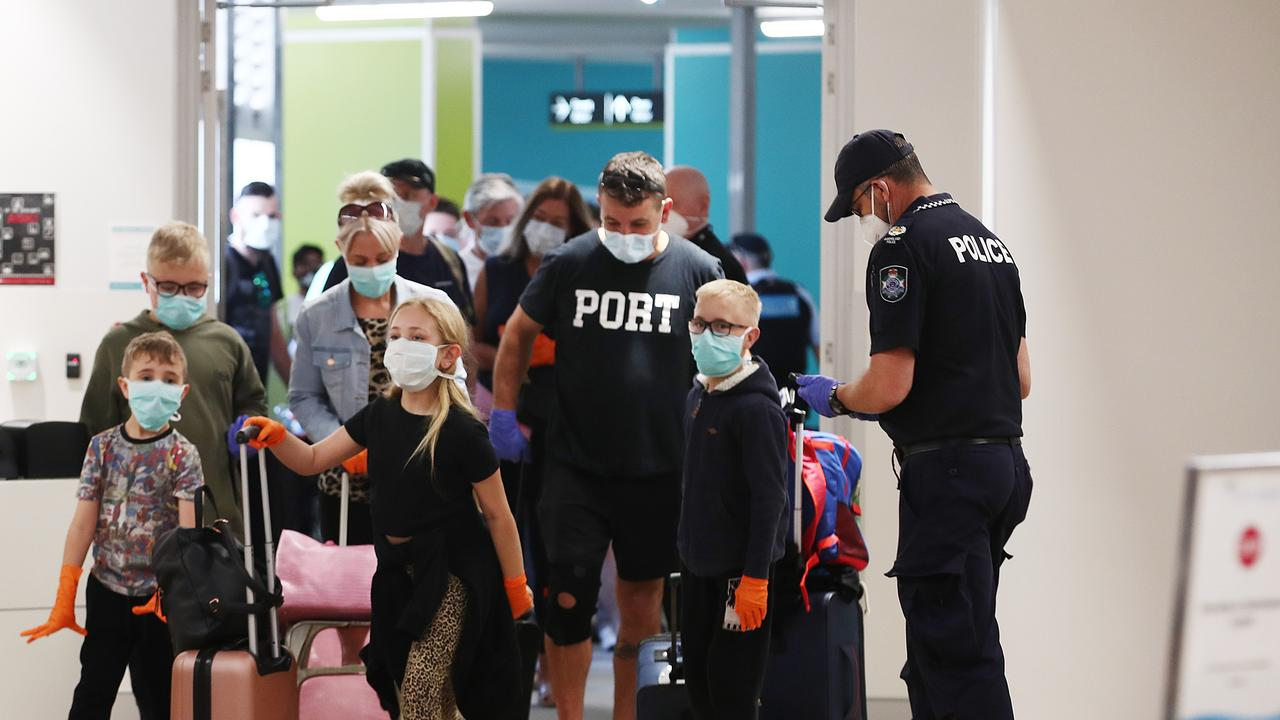 Queensland Police register the details of all passengers arriving from Adelaide at Cairns Airport, less than 24 hours before a mandatory quarantine for passengers comes into effect. Picture: Brendan Radke