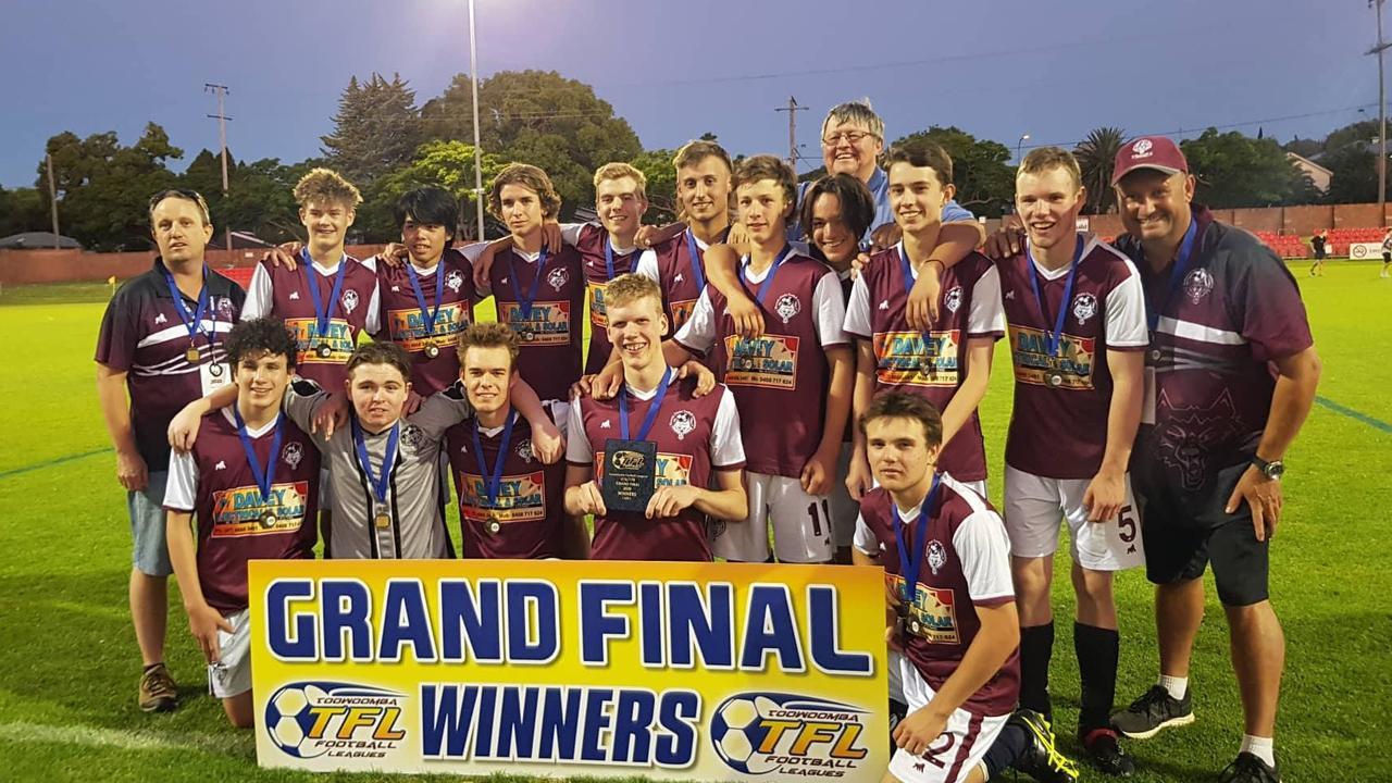 Warwick Wolves U16s/17s team celebrating their grand final win. Photo: WDFA
