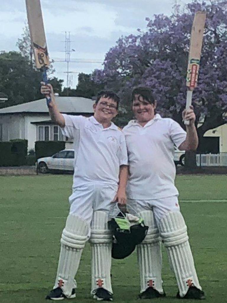 Westlawn's Eli Jones and Sam Buggy raise the bat after a top notch batting effort in 2018.