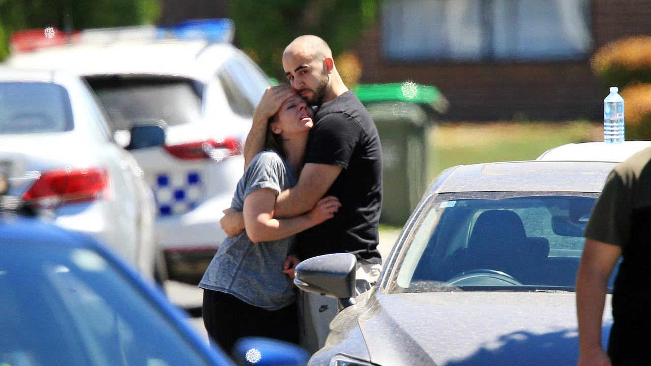 Bystanders console each other afte the death of Celeste Manno in Mernda. Picture: Mark Stewart