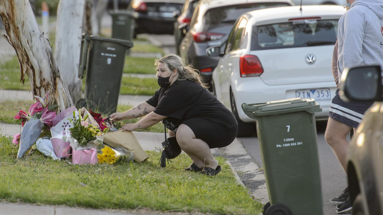 A person lays flowers at the scene. Picture: Jay Town