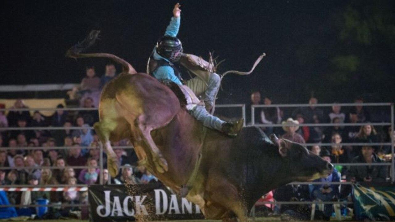 Matthew Bee in action as a bull rider. Photo: Adam Hourigan