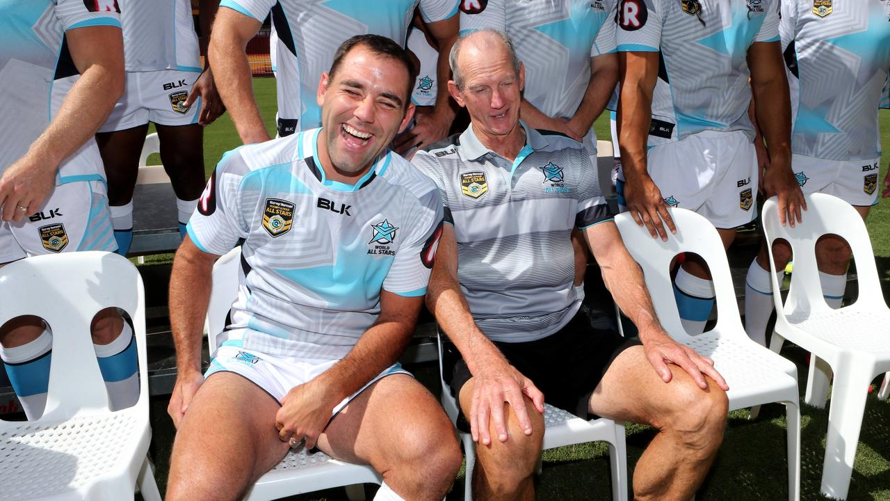 Cameron Smith and coach Wayne Bennett share a joke during the team photo for the World All Stars in 2016. Picture: Darren England