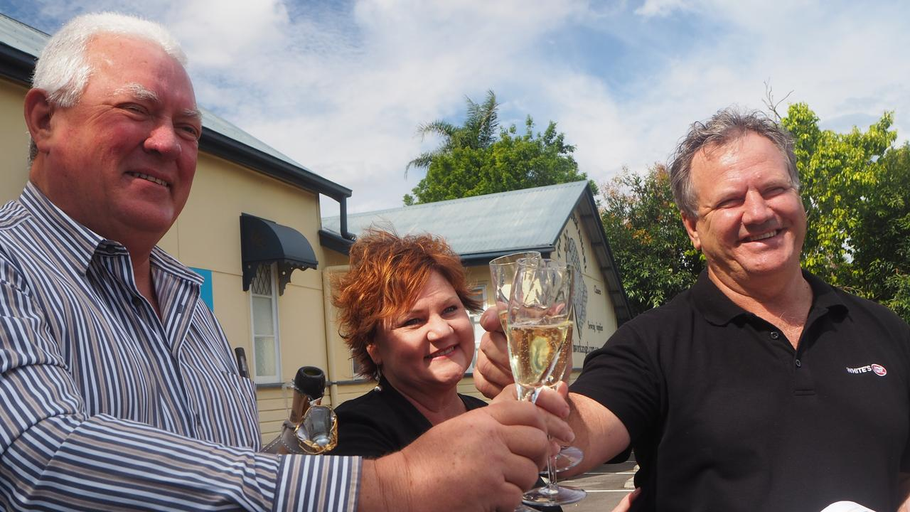 Sancus Property principal Tony Riddle and Whites IGA owners Roz and Michael White celebrate the approval of the Forest Glen Village Centre development.