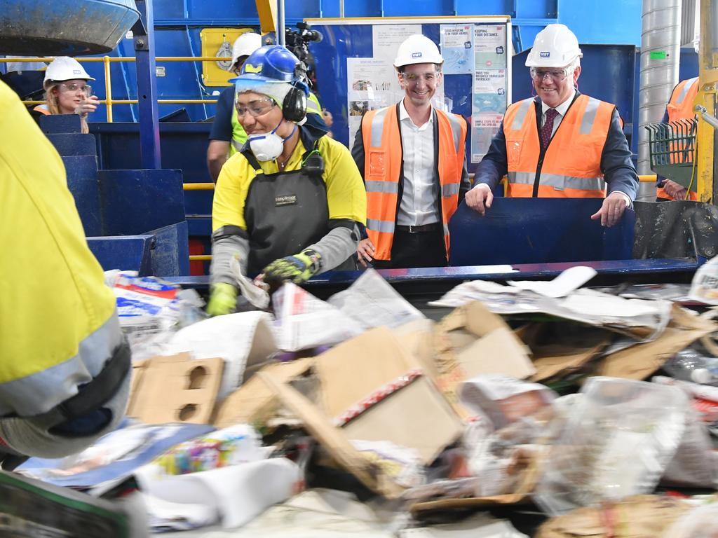 Assistant Minister for Waste Reduction and Environmental Management, Trevor Evans (centre) and Australian Prime Minister Scott Morrison (right) are seen during a tour of the Visy Recycling Facility in Brisbane last month. Around 60 per cent of Australian paper and cardboard is recycled. Picture: AAP Image/Darren England via NCA NewsWire