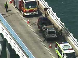 Mystery man who fled Bribie Island bridge inferno found