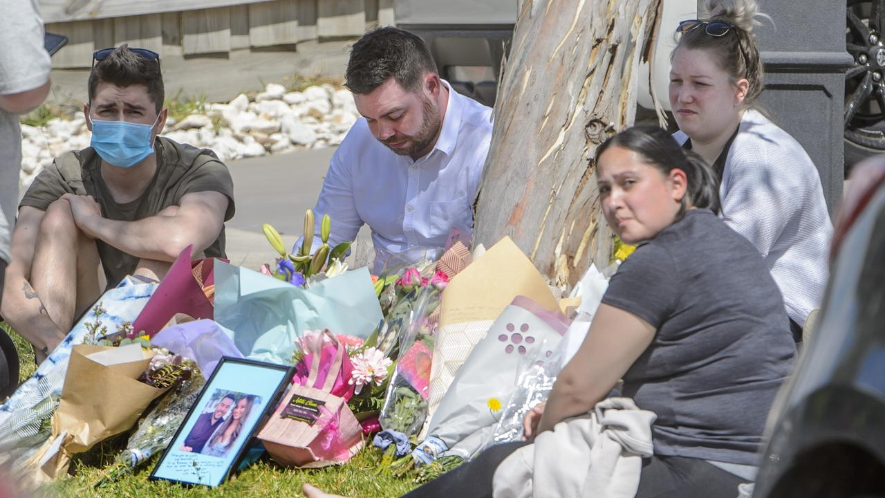Celeste's boyfriend Chris is surrounded by mourners at the scene outside the house. Picture: Jay Town