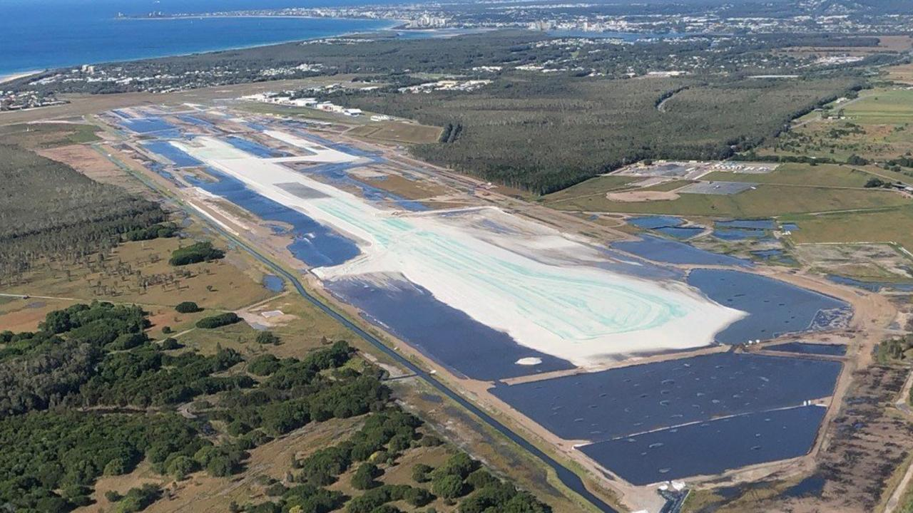 The Sunshine Coast Airport runway construction site inundated after a deluge.