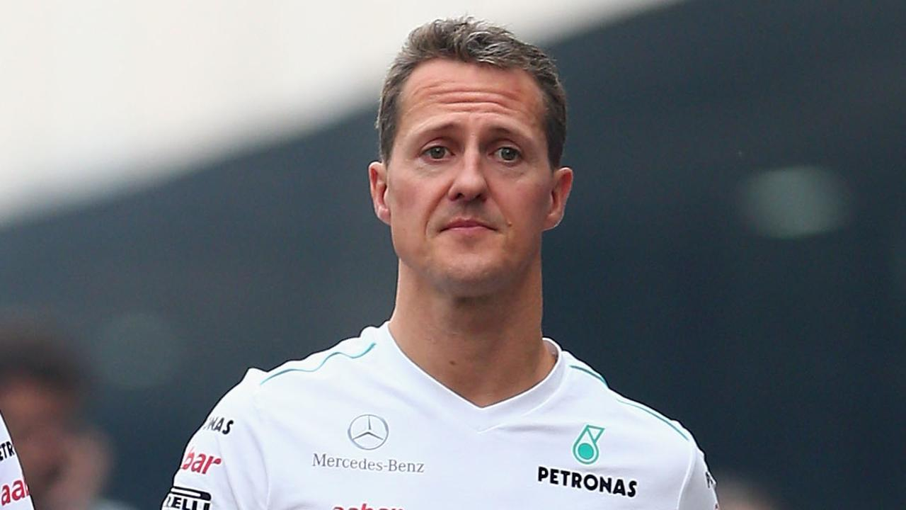 NOIDA, INDIA - OCTOBER 26:  Michael Schumacher of Germany and Mercedes GP walks in the paddock following practice for the Indian Formula One Grand Prix at Buddh International Circuit on October 26, 2012 in Noida, India.  (Photo by Clive Mason/Getty Images)