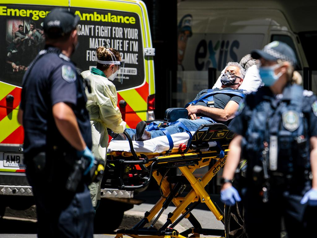 A man is taken away in an ambulance after coming out of Peppers yesterday. Picture: Morgan Sette