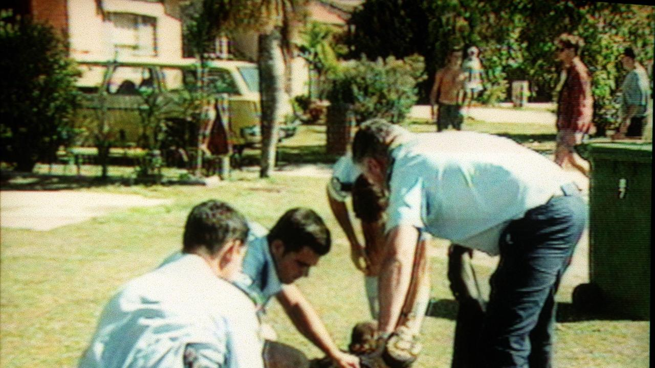 An injured person being treated after the shooting in Tugun on November 9, 1996. COURTESY CH 9