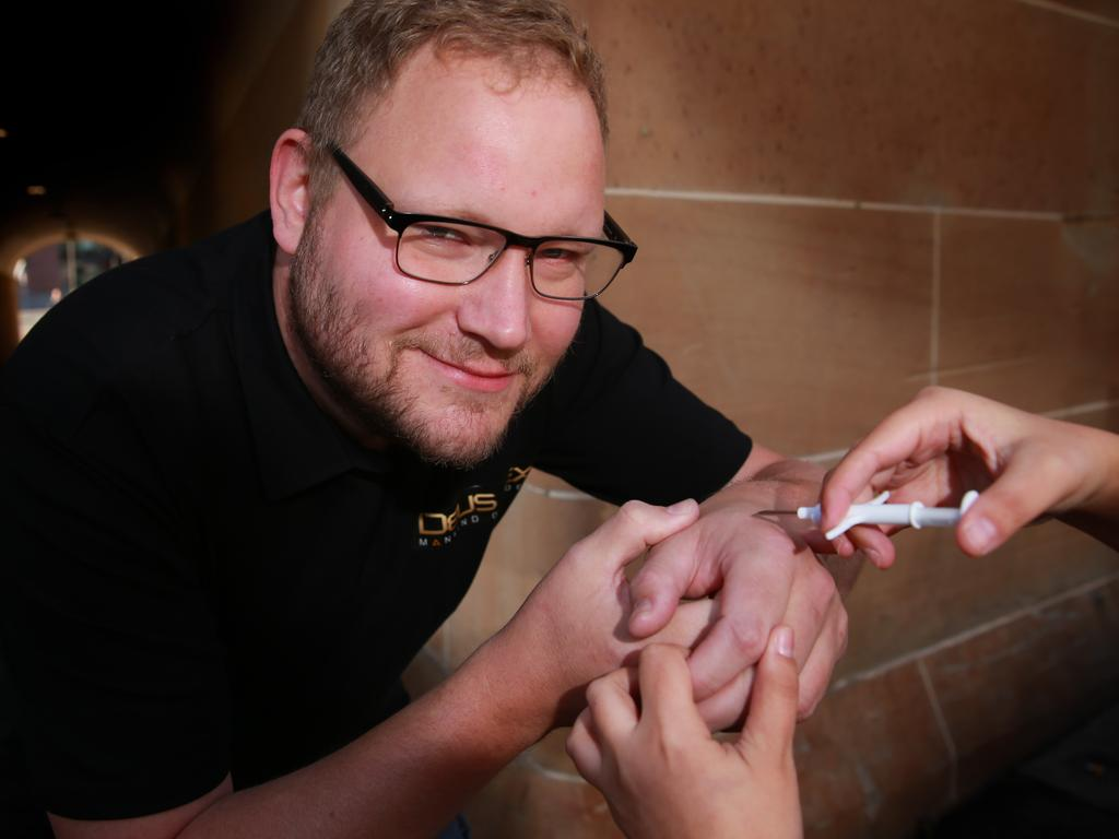 Amal Graafstra, the founder and CEO of Dangerous Things, pictured in 2016, demonstrating how you use a syringe to insert a xEM implant. Picture: Supplied.