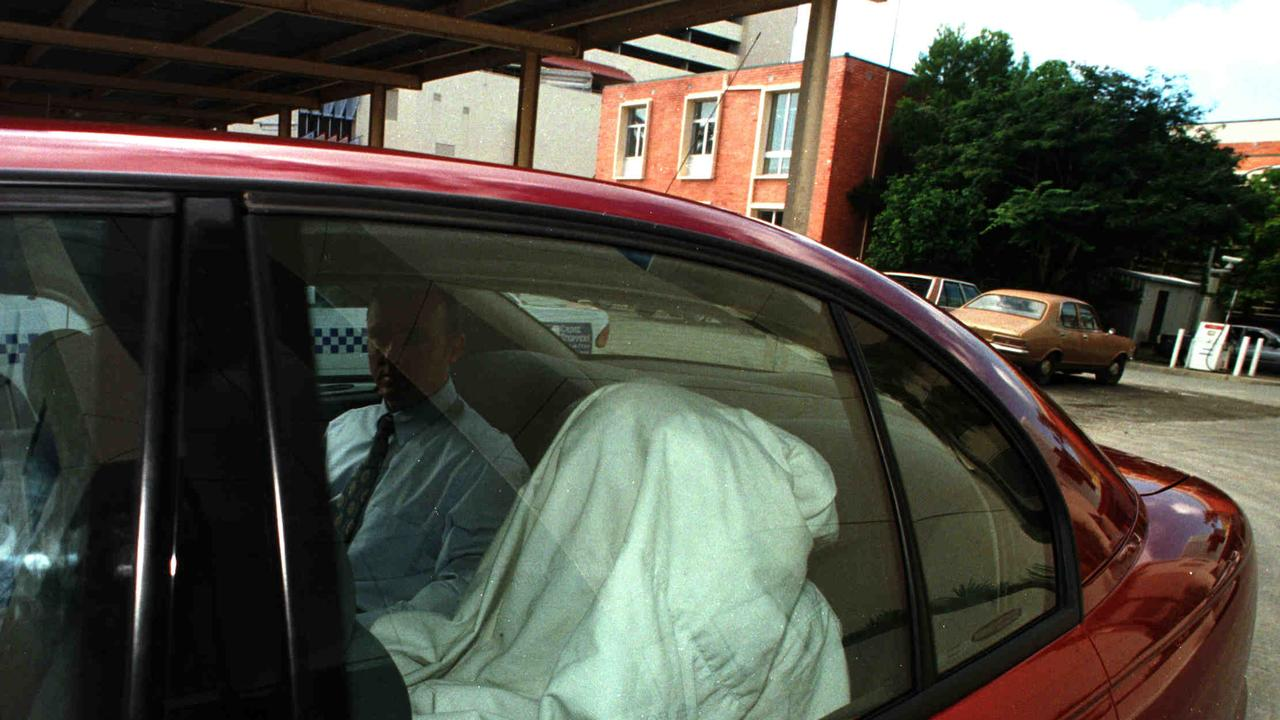 Kevin Baggott hides under a blanket as he is taken from Southport Court after being charged with the murder of his estranged wife Michelle. Picture: Paul Riley