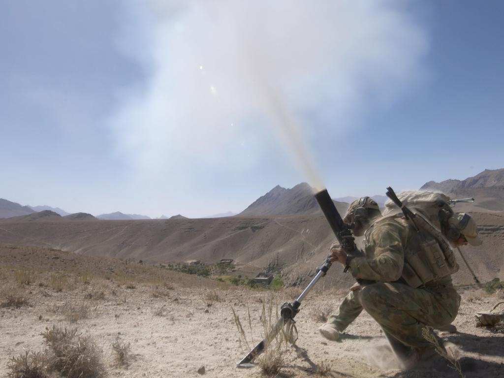 Soldiers from the Special Operations Task Group fire mortars on a Taliban position during a counter insurgency operation in Oruzgan Province, Afghanistan. Picture: Department of Defence