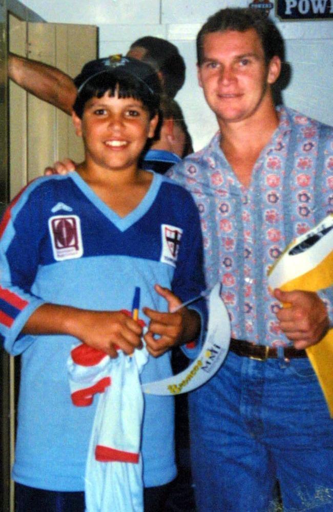 A 10-year-old Carl Webb pictured with his hero, Allan Langer. Picture: Supplied