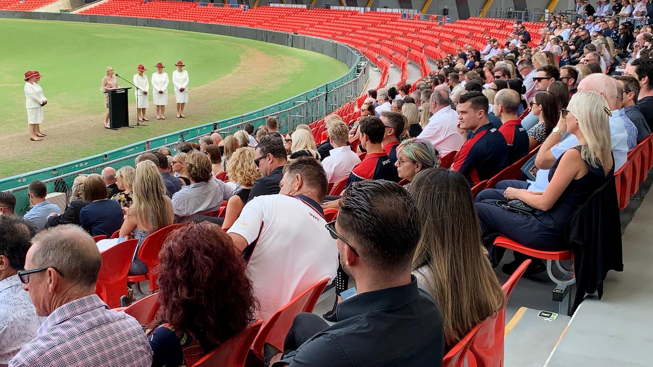 Mourners unable to attend a funeral for Jake Ryan, instead turned out for a memorial at Metricon Stadium on the Gold Coast. Picture: Scott Powick