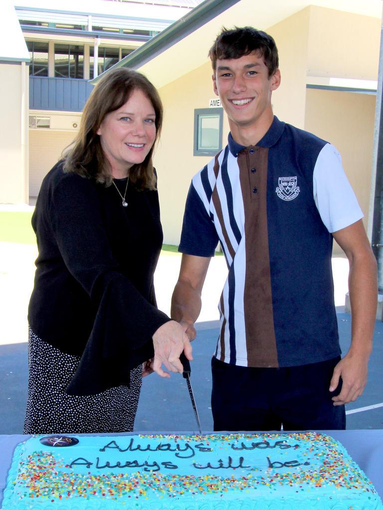 Principal, Kirsten Dwyer, helped Blake Iles cut the NAIDOC Week cake.
