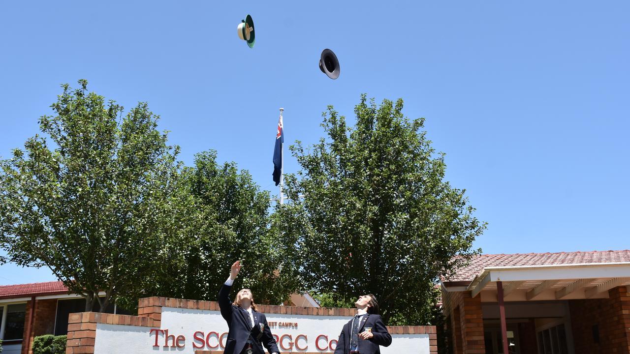SCOTS PGC school captains Kira Holmes and Josh Bailey celebrate graduating.
