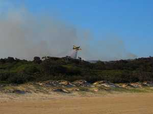 Aircraft brought in to waterbomb Fraser Island wildfire