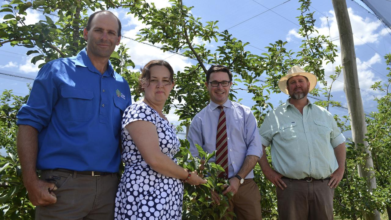 RESILIENCE: Daniel and Toni Nicoletti stand with MP David Littleproud and GBGA president Angus Ferrier in front on the gorgeous Nicoletti Orchards for the National Ag Day celebrations.
