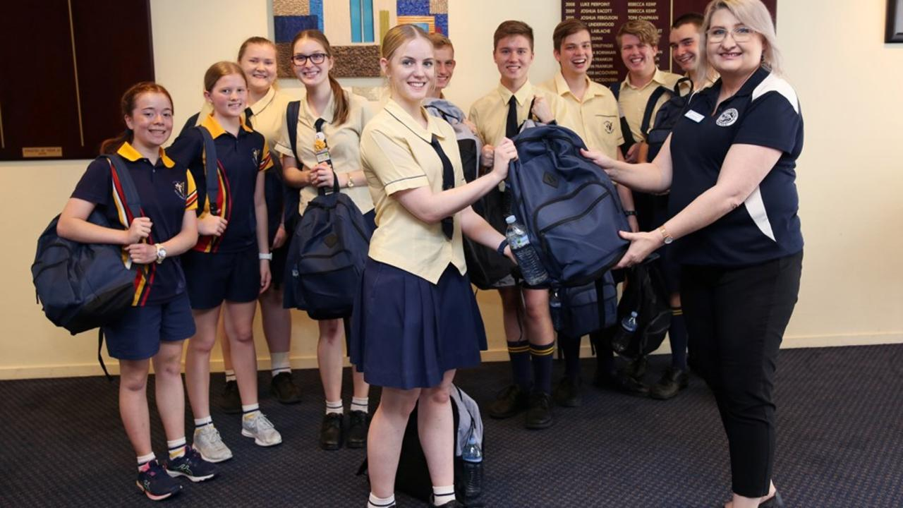 Holy Spirit College students (from left): Lily Paul, Teah Thatcher, Jessica Dorl, Rebecca Flor, Ella Donnollan, Hamish Dollan, Jack Thatcher, Lachlan Mattes, Marcus Ackerman and William McVeigh handing over 'Backpacks for the Homeless' to St Vincent De Paul's Annamaria Capello. Picture: Contributed