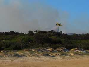 Bushfire started by illegal Fraser Island campfire burns on
