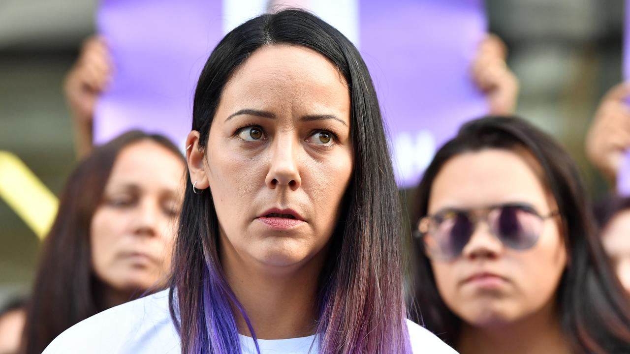 Cindy Palmer (centre), the mother of murdered schoolgirl Tiahleigh Palmer, speaks to the media outside the Supreme Court in Brisbane, Friday, May 25, 2018.