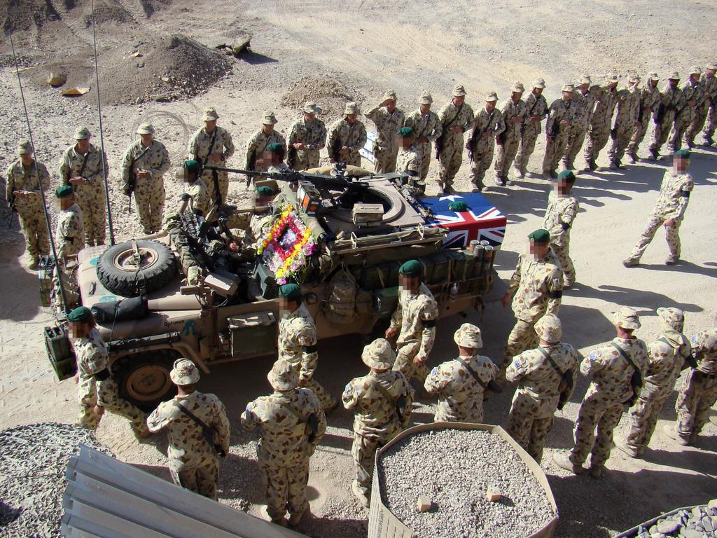 Special Operations Task Group troops escort a patrol vehicle carrying the casket of SAS commando Lance Corporal Jason Marks during a Ramp Ceremony at their base in Oruzgan Province, southern Afghanistan.