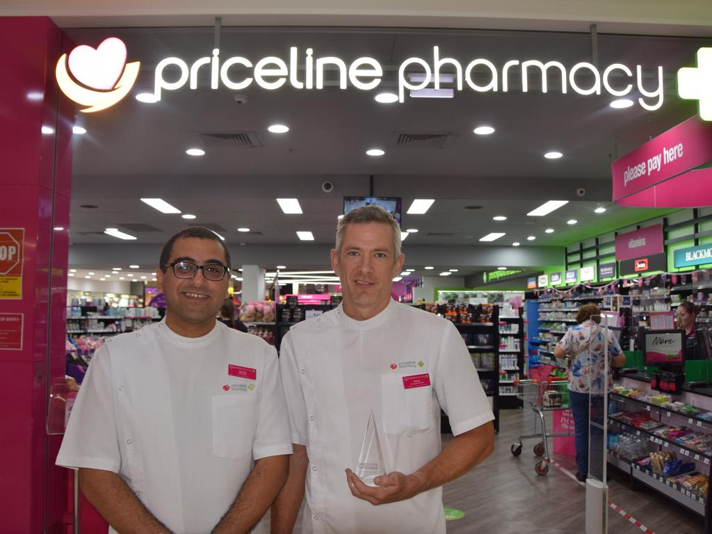 Pharmacist Ahmed Elkalla and co-owner Dan Carpenter with their award for top Priceline store in Australia.