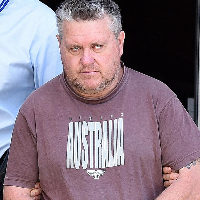 Rick Thorburn being escorted by police from the Logan Central Police Station on September 20, 2016. AAP Image/Dave Hunt