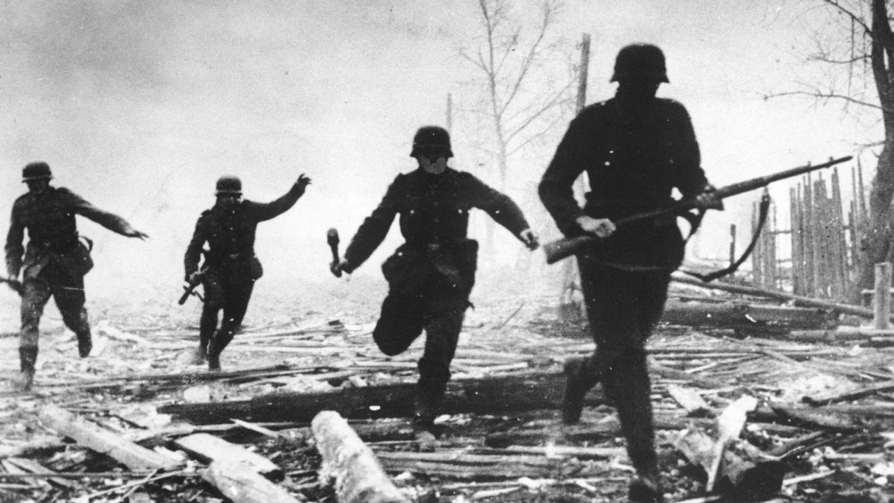 Confronting topic … children are often fascinated by WWII. This 1941 picture shows German soldiers advancing against Red Army positions in the Soviet Union.