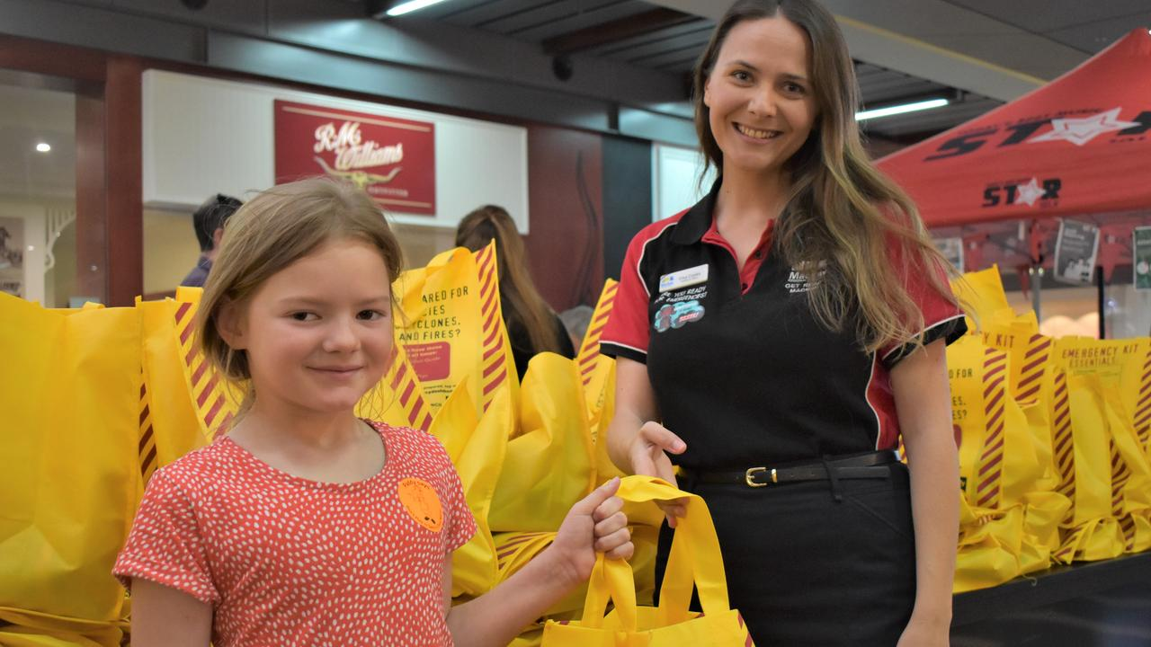 Neve Daly, 7, with Mackay Regional Council emergency management team member Elisa Crooks at the annual Cyclone Saturday event held at Caneland Central, November 21. Picture: Heidi Petith