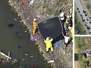 Two children killed as car flips off road into dam